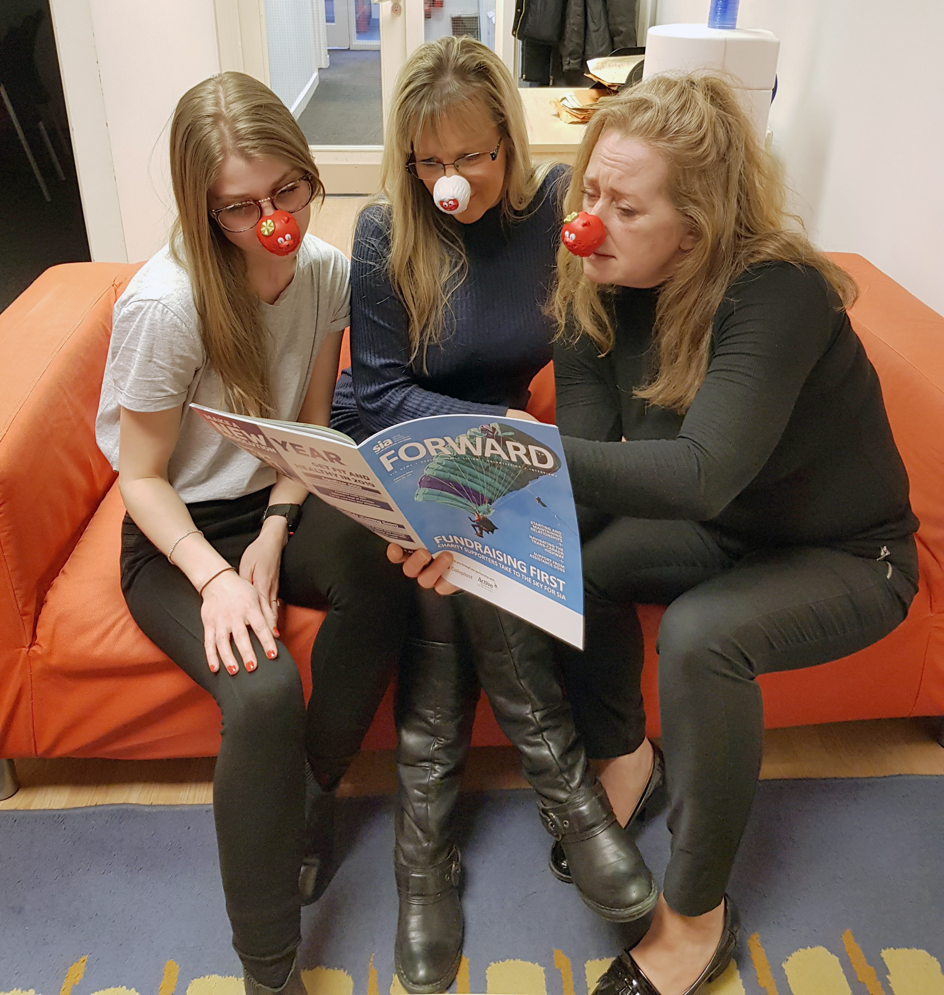 Business Services Team engrossed in a magazine